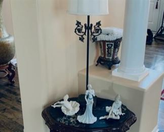 End table with oval marble insert.