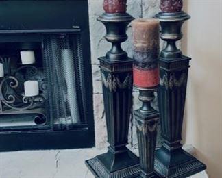 Tall fireplace candle sticks.