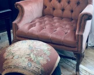 Tufted wing back chair and ottoman.