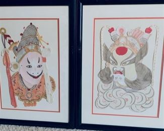 Painted paper cut out Asian characters.