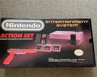 1990 Nintendo  Entertainment System (NES) Action Set,  Mint Condition.  Complete w/Box,  Console,            2 Controllers, Zapper & 2 Games.  Duck Hunt & Super Mario Bros.  $200