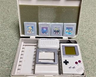 Nintendo Gameboy w/ case, magnifying screen & 4 games $200 For the entire case