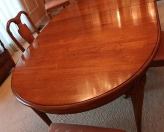 24  Dining  room  table-table  and buffet  are  sold  as  a  set  There  are  leaves  and  pads.      Table  has  8  chairs    price  695.00