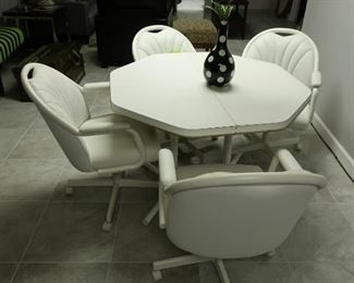120    chrome craft dinette set (has one leaf)   Price  is  275.00