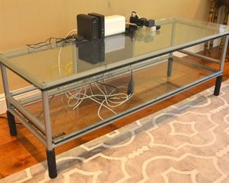 "13. Lot F13 (0021.jpg) - Entertainment Center - 2 Tier Glass on Metal Frame - 58"" wide (long) x 21"" deep x 18 ¾"" High; 5/8"" Thick Glass. Custom Made by Billy Bags Company."
