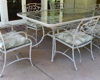 "42. Lot F42 (0094.jpg 0095.jpg)  – Tropitone Cast Aluminum, Glass Top - Patio Table with 6 Chairs and Pillows. Table: 72"" (6 feet) – long, 41"" Wide. Chair: 33"" High Back, 21.5"" wide."