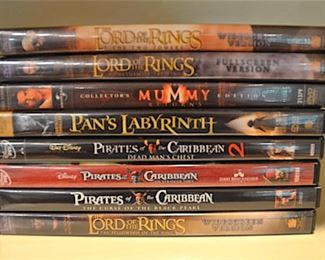 182 Lot D004 – 0350.jpg  – 8 DVDs Lord of the Ring; Pirates of the Caribean