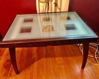 Glass top table .......... that converts to a dining room table
