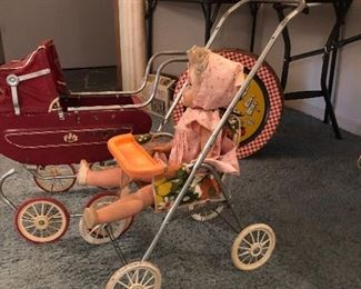 Vintage toy stroller and baby buggy