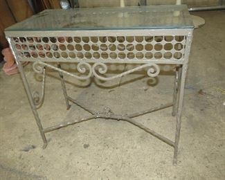 """ITEM 22-- Vintage painted iron glass top table with floral center. 24"""" long, 12 """" wide, 21 1/2"""" high   $95.00"""
