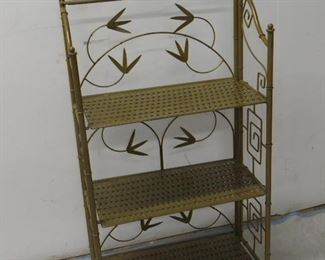 """ITEM 14 -- faux bamboo metal folding shelf with floral and Greek key design. 21"""" wide, 10 1/2"""" deep, 46"""" high. $75.00"""