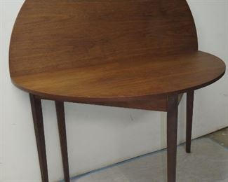 """ITEM 11 --  MCM walnut flip top demilune console/dining table, has surface blemishes. open is 48"""" diameter, 29"""" high $275.00"""