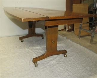 """ITEM 13 --  walnut drop side convertible coffee table into dining table, 60"""" long, 40 1/2"""" wide, 27 1/2 """" high  $120.00"""