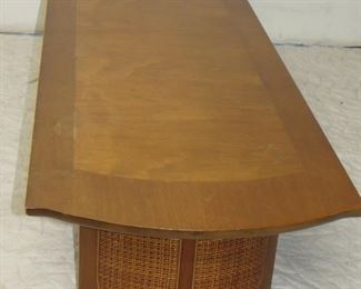 """ITEM 15 --- Mid century modern coffee table with cane ends. [has small chip bottom of end, see photo] 72"""" long, 22"""" wide, 15"""" high  $150.00"""