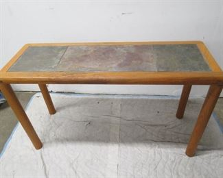 """ITEM 19--Teak and slate top table, Denmark [signed Haslev] worn  spot on edge,  48"""" long, 17"""" wide, 28"""" high  $175.00"""
