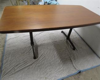 """ITEM 20-- Large Walnut table with metal base, signed steelcase. 65"""" long, 35"""" wide, 29"""" high.   $375.00"""