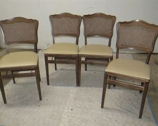 ITEM 24-- Set of 4 provincial cane back folding chairs. $125.00