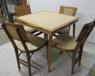 ITEM 26---MCM cane back set of 4 folding chairs and vinyl top folding table.  $225.00