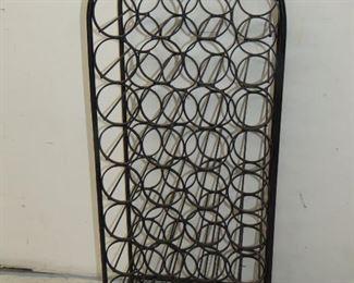 "ITEM 42-- Arthur Umanoff style  39 bottle iron wine rack  43"" high, 17' wide, 12"" deep, some minor rusty spots.  $275.00"