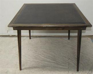 "ITEM 57---MCM vinyl top folding card table. 28 1/2"" high , 34"" square.  $75.00"