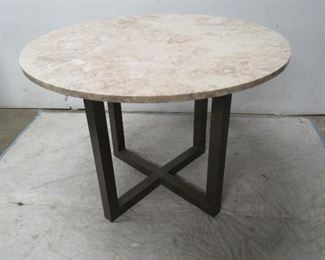"""ITEM 59--- MCM brass and marble top dining table. 40"""" diameter, 29"""" high. [minor rim chips].  $450.00"""