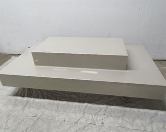 """ITEM 63---Lucite tiered coffee table. 50"""" long, 27"""" wide, 10"""" high. $175.00"""