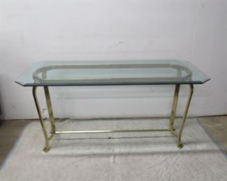 """ITEM 64---Hollywood Regency brass console table. [small chip underside glass] 54"""" long, 24"""" wide, 26"""" high. $ 100.00"""