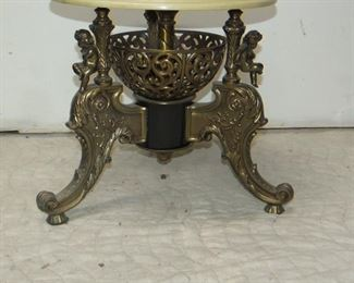 Classical style figural gilt metal, composition marble top pedestal with cherubs.  PIC 2