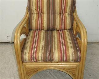 "ITEM 72---Rattan armchair palm tree motif. 26.5"" wide,32"" deep, 30 3/4"" high, seat height 12"" -w cushion 16"", $125.00"
