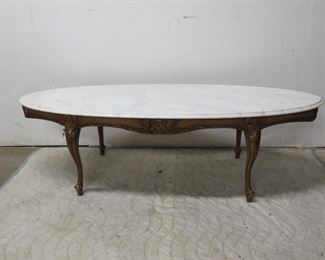 """ITEM 131---carved marble top table, [chip end of marble].60"""" long, 22' wide,17 3/4 high,  $125.00"""