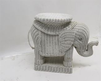 """ITEM 87---wicker elephant table / plant stand, tail is loose at bottom. 26"""" long, 10"""" wide, 20"""" high. $40.00"""