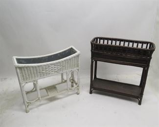 """ITEM 89---2 wicker planters with metal liners inside. Newer Brown planter measures 30"""" long, 12"""" wide, 31"""" high.  White- 31"""" long, 9.5"""" wide, 27"""" high  $75.00"""
