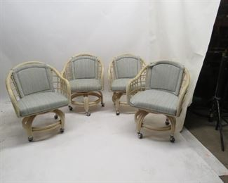 """ITEM 97---4 rolling rattan upholstered swivel dining chairs, marks on material, 24"""" wide,23"""" deep,31"""" high. 17"""" high to seat. $160.00"""