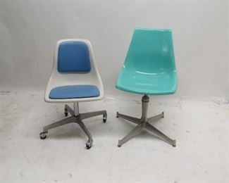 ITEM 107---2 MCM plastic swivel chairs. surface marks , 1has chip see photo.  $50.00