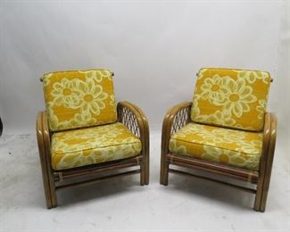 """ITEM 108---Pair of rattan chairs. 24.5"""" wide, 31.5"""" deep, 27"""" high, 11.5"""" high to seat. $ 200.00"""
