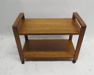 """ITEM 113---MCM danish teak rolling cart with dovetailed corners. 31"""" long, 16"""" wide, 23 1/4 high. surface blemishes,                $ 75.00"""
