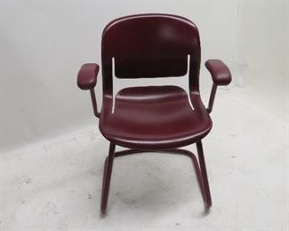 ITEM 118---Herman Miller plastic armchair with metal base. some surface scratches. $60.00