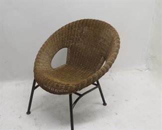"""ITEM 120 ---contemporary wicker hoop chair [ has some wicker damage] 29"""" wide, 30"""" deep, 29.5"""" high, 17"""" to seat  $ 60.00"""