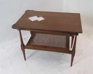 """ITEM 126---MCM end table with tile inserts and caned base. [surface crackling} 19.5"""" wide, 27 3/4"""" deep, 21 1/4"""" high  $150.00"""