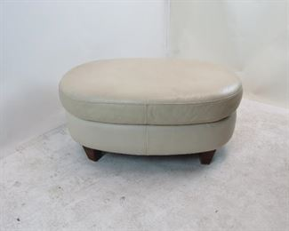 """ITEM 134---contemporary oval leather ottoman.small marks on leather,  38"""" long, 24"""" wide, 17""""high   $50.00"""