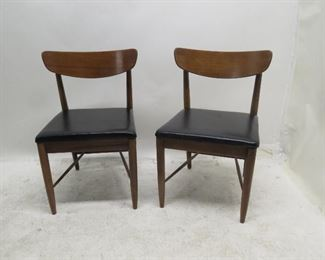 """ITEM 135 ---pair MCM walnut chairs. [missing 2 screw covering buttons].  21 3/4""""w, 20"""" deep, 31"""" high.  $100.00"""