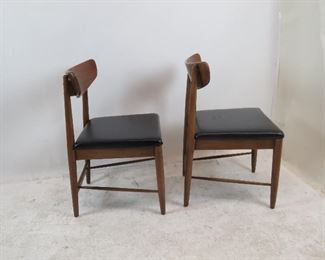 pair MCM walnut chairs. [missing 2 screw covering buttons].  PIC 2