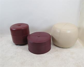 """ITEM 138 ---3 contemporary ottomans, white leather is scuffed  22"""" diameter, 17"""" high, tall burgundy 17"""" diameter, 17"""" high, short burgundy,19.75"""" diameter, 10"""" high  $60.00"""