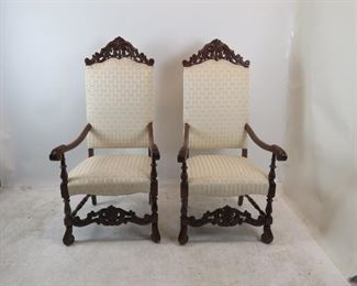 """ITEM 144---Pair of Jacobean hand carved walnut throne arm chairs. 26"""" wide, 27"""" deep, 53.75"""" high, 18"""" h to seat. $500.00"""