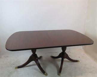 "ITEM 148 ---Henkel Harris mahogany double pedestal table w 3 leaves, model 2208. 44"" wide,29.75"" high, 68"" long closed, plus 3 -12"" leaves.  $1900.00"
