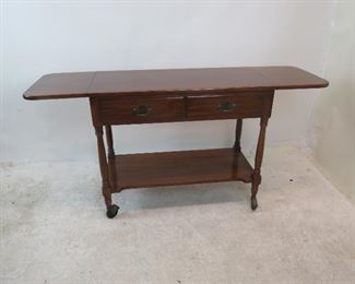 """ITEM 151 ---Henkel Harris drop-side cherry server {wheels need to be re-inserted].   61"""" leaves open, 38.5 leaves down, 18"""" wide, 31"""" high w wheels. 27.5 without wheels.  $450.00"""
