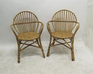 """ITEM 152 ---pair rattan wicker chairs. [needs some re-wrapping]. 25 3/4"""" w, 24"""" d, 34.5"""" h, 15.5 to seat.  $75.00"""