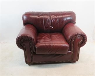 """ITEM 154 ---Robinson and Robinson leather arm chair with brass tacking. 48"""" wide,39"""" deep, 35"""" high. $500.00"""
