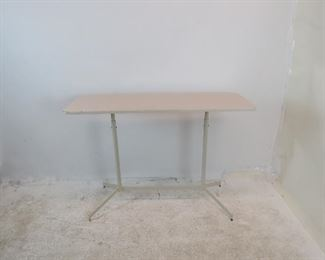 """ITEM 169 ---Laminate top metal base adjustable console table. [repainted border] base chipped paint.  48"""" long, 18"""" deep, 34 1/4"""" high. $100.00"""