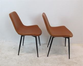 pair of contemporary leather chairs w/ metal bases.  PIC 2